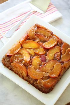 Peach Upside-Down Cake: flavoured with browned butter, whisky and ginger.. mMmmm (from zoebakes.com)