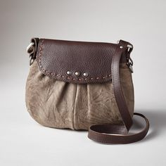 """SOJOURN HANDBAG--We love the combination of metallic and classic tobacco leathers in a sassy little bag with adjustable crossbody shoulder strap. Leather lined, one zip pocket. Made in USA of Italian leather. 9-1/2""""W x 3-1/2""""D x 8""""H. Each bag will be unique."""