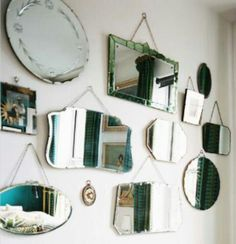 Wall of mirrors- love this idea