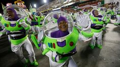 """""""Performers from the Uniao da Ilha do Governador samba school show off their costumes during carnival celebrations at the Sambadrome in Rio de Janeiro on Tuesday, March 4. Carnival is maintaining a frenetic pace as it nears its end in Brazil, with hundreds of roving parties taking over streets."""""""
