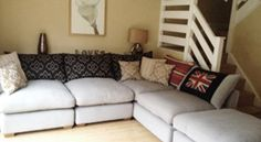 Hambledon Sofa in Andrew Martin Fisher.   This sofa and fabric can be ordered online.