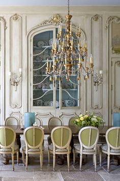 #thewelldressedroom-beautiful chandelier - love the china cabinet with the pretty color painted inside
