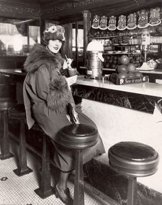 Actress Claire Windsor 1920s publicity shot hat coat shoes soda fountain drugstore photo print ad model movie star ? vintage fashion style found photo