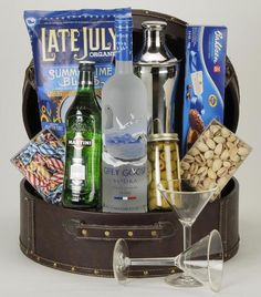 GREY GOOSE MARTINI BASKET A beautiful faux leather case filled with the makings of a great martini party. A bottle of Grey Goose Vodka, a martini shaker, vermouth, olives, nuts, cookies, candy and two martini glasses.