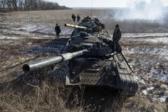 Tank crew of the separatist self-proclaimed Donetsk People's Republic Army stand on top of their tanks at a checkpoint on the road from the town of Vuhlehirsk to Debaltseve, Ukraine, February 18, 2015. REUTERS/Baz Ratner
