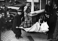 Unity Mitford being carried from a Folkestone hotel before being transported to her home in High Wycombe  4th January 1940