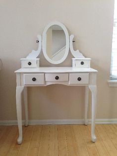 SOLD - Beautiful White Vanity Table Beautiful vanity table in great condition!  There are very minor spots on the table. Dimensions 31.5W X 51H X 16D www.relovedinteriors.com