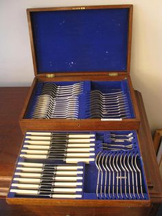 Antique Edwardian Period Oak Cased Canteen of Cutlery 70 piece By Christopher Johnson & Co Western Works Sheffield England Circa 1910  A beautiful Edwardian period 70 piece canteen of cutlery for six people consisting of dinner forks, dessert forks, table knives, dessert knives dessert spoons, table spoons, salt spoons and mustard spoons. In its original blue lined two tier oak and brass presentation cabinet. In good vintage condition with minor age related wear, two dessert spoons have b...