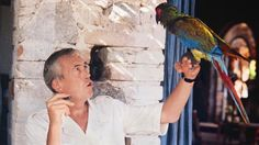 John Huston runs lines with a feathered friend during the filming of The Night of the Iguana (1964) in Mexico.