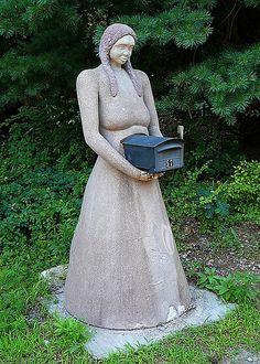 Lady holding mailbox