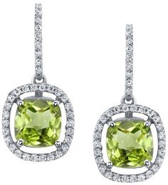 The halo drop earring design is a luxurious style of jewelry with simply dazzling sparkle.  The floating 6 x 6 mm peridot gemstones are the focal point of each piece and are each respectively surrounded by approximately 35 glittering G-H color SI diamonds that add up to approximately 0.40 cttw which complement and accentuate the beauty of the center gemstones.  The peridots also provide an extra layer of meaning and sentiment that asserts a sense of personal style by representing growth…