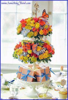 Tall, butterfly themed, floral arrangement centerpiece