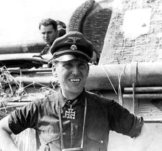 "SS-Standartenführer Johannes-Rudolf Mühlenkamp, the commander of the Wiking Division's Panzer Regiment and from 12 August 1944 the commander of the Division, photographed in the summer of 1944, east of Warsaw. While serving as commander of the Wiking Division, on 21 September 1944 he was awarded the Oak Leaves to the Knight's Cross. Note the ""Dracula"" smile."