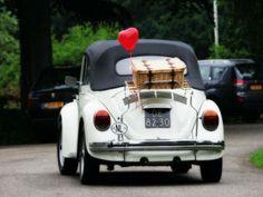 VW Kever Cabrio in off white!