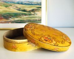 This beautiful vintage lemon yellow papier mache box with pink roses and brown scrolls was made in Japan, circa 1930s. The design has some embossed