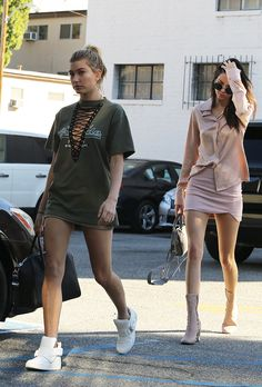 IT GIRL Style: Hailey Baldwin in a mini lace-up dress + white sneakers, and Kendall Jenner in a pastel pink ensemble with matching suede midi boots