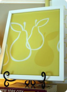 Need a pop of color?  Find a cheap plastic placemat from the dollar store and trim it to fit a pretty frame.  Bingo!