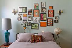 I like the use of a low shelf headboard (maybe a console table) and the picture gallery wall above (not crazy about the lamps) {smile}