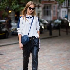 Casual, zip front, athletic style top paired with leather pants.   styledumonde