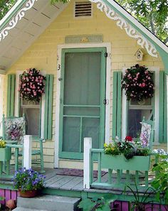 Tiny cottage home- what a fabulous porch with flowers.