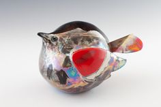 This one-of-a-kind bird sculpture is a sight to behold. Those colors!