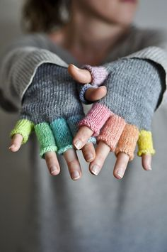 Ravelry: wonderliza's Rainbow mitts ....this is knit but would be cool crocheted