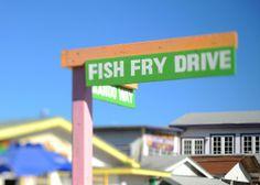 To get a true taste of paradise, head to Arawak Cay on West Bay Street in Nassau.