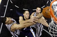 Memphis Grizzlies Tayshaun Prince goes up for a shot against San Antonio Spurs Danny Green, left, and Manu Ginobili, of Argentina, during the first half in Game 2 of the Western Conference finals NBA basketball playoff series, Tuesday, May 21, 2013, in San Antonio. (AP Photo/Ronald Martinez, Pool)