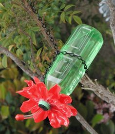 Hummingbird feeder made from reccled bottle and melted plastic spoons.