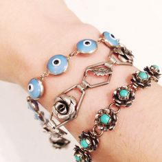 Layering bracelets - vintage evil eye (Sterling and glass), vintage BEAU Sterling rose and leaf bracelet, and a vintage Mexican silver with turquoise bracelet. StaceyFayDesigns.etsy.com