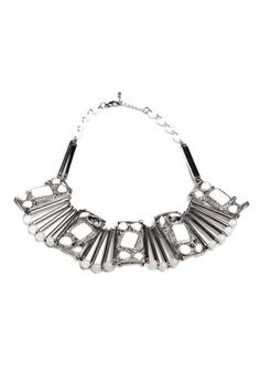 White stone bib necklace with metal silver tubes. Wear it tight around your neck as a choker! Available at www.shoptiques.com
