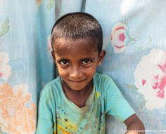 One Khasi tribal boy posing in front of the camera (very close portrait), Khasi tribe,  Nirala Para (village), Sreemangal (Srimangal), Division of Sylhet, Bangladesh, Indian Sub-Continent, Asia