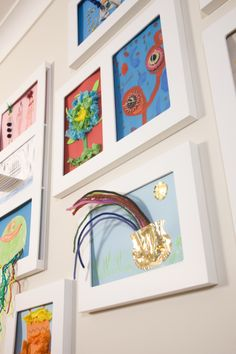 wall frames designed to display children's artwork. Get it off the fridge..
