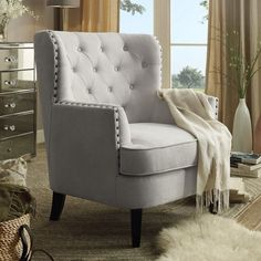 Complete your parlor or den ensemble with this lovely tufted arm chair, perfect for extra guest seating or lounging with a Sunday-morning cappuccino.