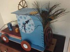 I made this steampunk train out of cardboard and a peacock feather.