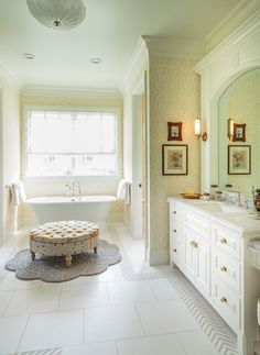 Bathroom. Traditional Bathroom. Traditional Bathroom with Wallpaper. Traditional Bathroom with wallpaper and ottoman by freestanding bath. #Traditional #Bathroom