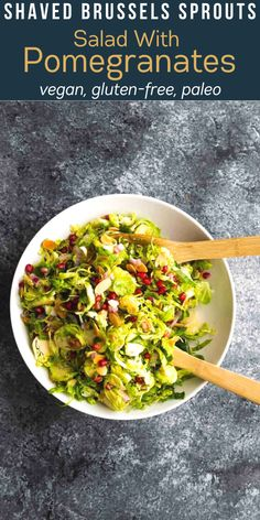 This shaved brussels sprouts salad is made with almond slices, sweet pomegranate seeds, and a tangy white wine vinaigrette. A perfect holiday side dish that comes together quickly. This recipe is vegan, gluten-free, paleo. #sweetpeasandsaffron #mealprep #salad #thanksgiving #christmas