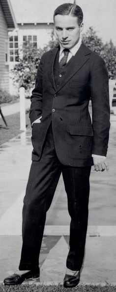 Charlie Chaplin on the grounds of his studio - 1918.  I enjoy finding high def photos as you spot so much detail. Here you can spot a cigarette in his left hand.