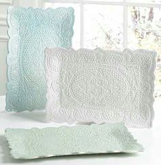 Made from clay. Roll flat to thickness you want. Lay doily on top and roll pattern in. Cut outer edge.