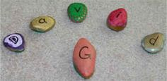 Day 11 Advent, paint rocks, add felt to bottom,  try and knock G rock out of square