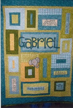 Personalized baby name quilt - bottom square has birth information (height, weight, date of birth) option to add a family photo personalized label to the back.