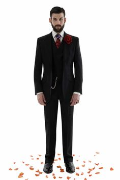 Black 3 piece suit, white shirt and floral silk tie