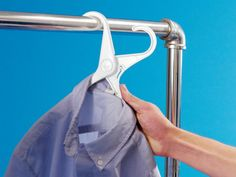 Watch in amazement as you remove a blouse from its hanger … with one hand! Folding hangers by Quirky pop open and closed for easy removal from the closet. They also allow you to insert a hanger without having to stretch out the shirt collar or unbutton the top button. Magic, indeed.