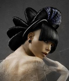 A long black straight quirky avant garde hairstyle by X-Presion