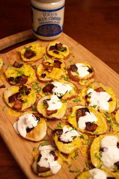 Easy recipe for a game day watch party! Potato skins drizzled with the BEST Blue Cheese Dressing.   Roast slices of potatoes on a baking tray until soft. Add cheddar cheese and cooked bits of bacon until cheese melts. Drizzle with Blue Cheese.