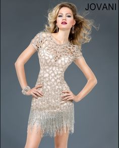 Sexy light gold short dress features a cut out neckline and cap sleeves with a beaded fringe detail skirt. Perfect for a night out. Jovani style 77485.