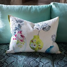 Celeste as a gorgeous cushion framing the intricately hand painted vases