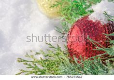 Christmas border with garland of fir branches, red and gold baubles. Holiday decorations on white snow background