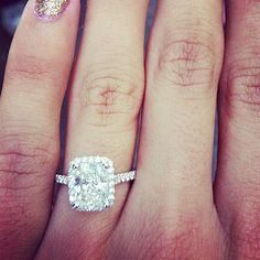 I'm not one for putting engagement rings all over my Pinterest-but this one is to die for!