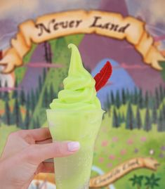 """A Peter Pan ice cream float, currently available at Storybook Treats at Magic Kingdom Park in Walt Disney World, features key lime ice cream, lemon-lime soda, and a chocolate """"feather. Comida Disney World, Disney World Food, Walt Disney World, Disney Worlds, Disney Parks, Disney Disney, Disney Tips, Princess Bubblegum, Adventure Time Anime"""
